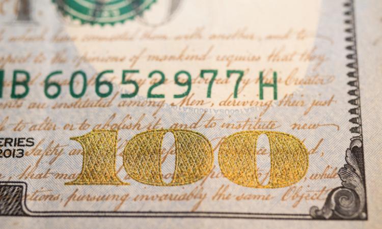 close up of 100 dollar bill right corner