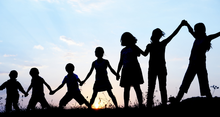 Chain of children in height order holding hands.